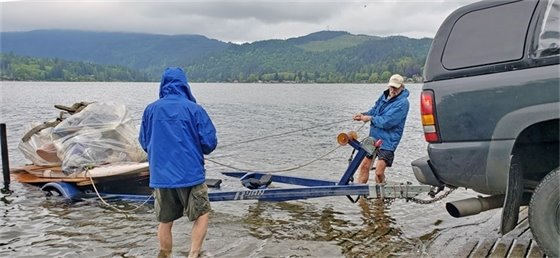 Lake Samish residents remove Styrofoam waste from a floating platform constructed out of two stand-up paddle boards and plywood tied together that was affectionately called the STB.1 for Styrofoam Transportation Barge. The Lake Samish Association organized the cleanup and partnered with Whatcom County and other agencies for the removal of 40 yards of Styrofoam from the lake area.