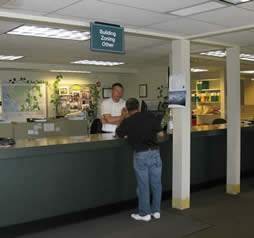 Person being helped at the county of the Permit Center