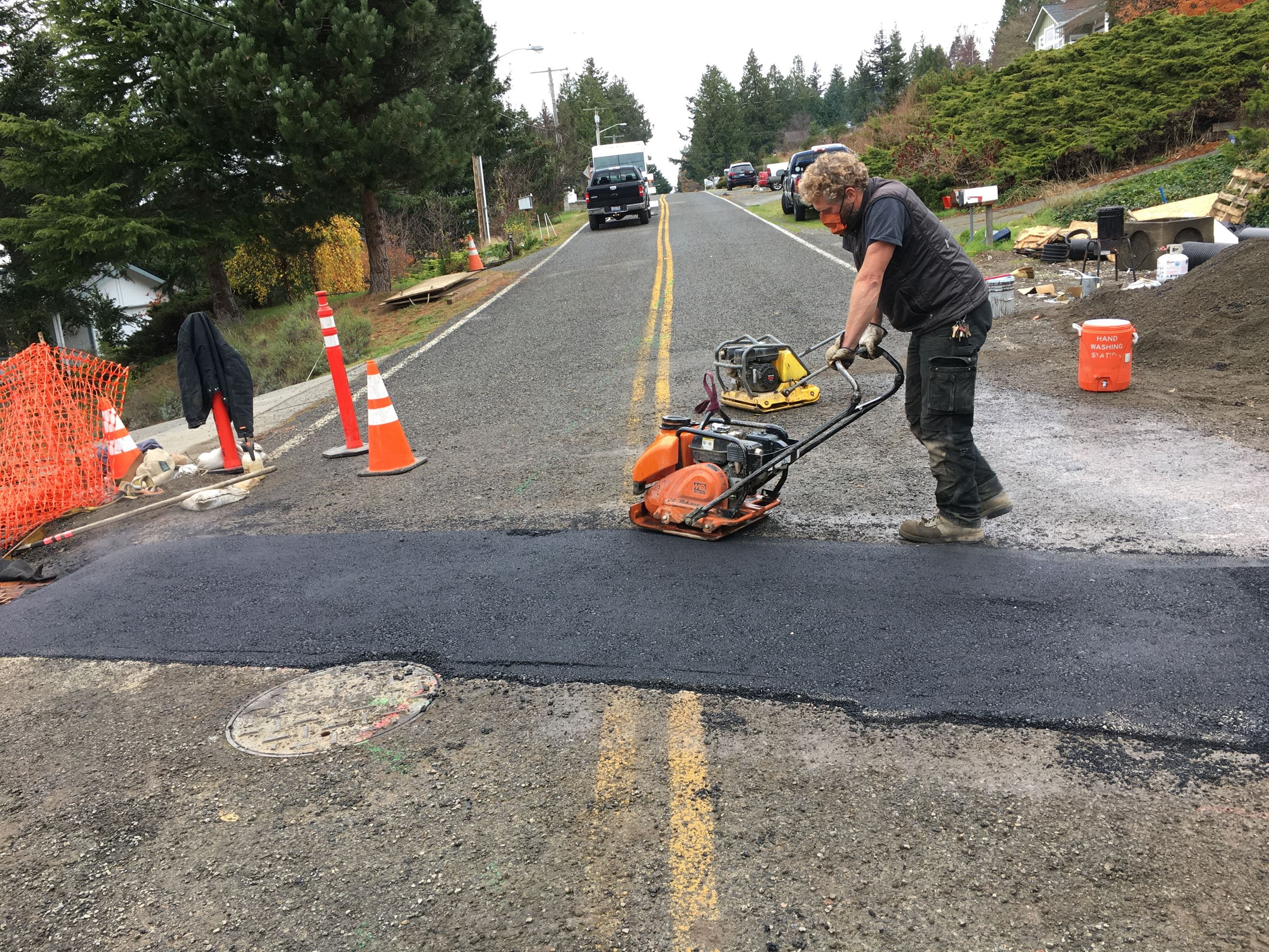 Installing temporary asphalt road patch.